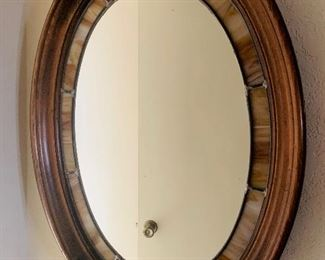 Walnut and stained slag glass oval mirror