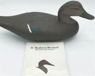 Signed Madison Mitchell black duck decoy (1974), comes with book entitled R. Madison Mitchell by Charlie Lee Robbins (out of print)