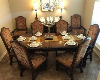William and Mary English manor style dining room table with eight chairs and one leaf. Seats six without leaf, eight with leaf.