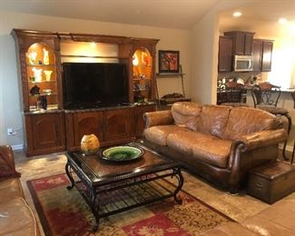 Lighted entertainment center, down leather sofa, wrought iron cocktail table