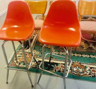pair of Retro Molded Fiberglass Bar Stools .Not Eames but looks so much like it. Featuring Bright Orange seats &  Chrome Legs .