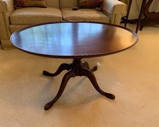 #6 Cherry oval pedestal coffee table $75