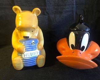 Vintage Winnie the Pooh cookie jar and 1994 Daffy Duck cookie jar