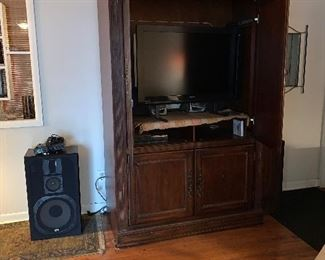 "36"" Magnavox flat screen television, entertainment center"