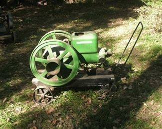 John Deere E-Series engine.  It is larger than a 1 1/2 hp engine and is believed to be a 3 hp engine.