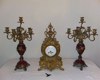 Antique French Louis XV Style mantel clock. Working - Gilt Bronze case w/ dolphin and scroll. Enameled dial. Marked on case L.F. (LouisFernier?) Gorgeous Pair of Antique Louis XV style six-light candelabra w/ porcelain baluster bases, gilt bronze mounts and floral scroll arms w/ bobeches