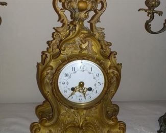 Antique French Louis XV Style mantel clock. Working - Gilt Bronze case w/ dolphin and scroll. Enameled dial. Marked on case L.F. (LouisFernier?)