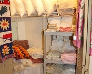 linen closet with pillows