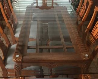 Very nice glass top table with 6 chairs.  This table is priced to sell.