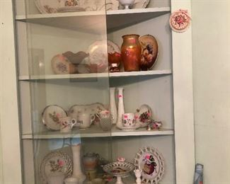 Corner cabinet filled with glassware