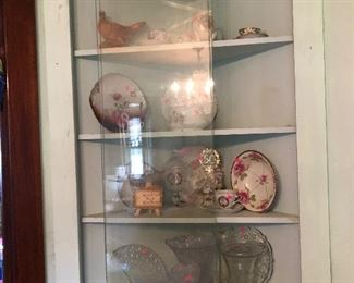 Another corner cabinet filled with glassware