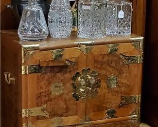 Smaller Korean chest. Inside consists of many small drawers.  Crystal Decanters (these and more).  Beer steins - tall and short