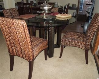 Pottery Barn round table set.  Wood pedestal base with glass top.  4 matching woven chairs