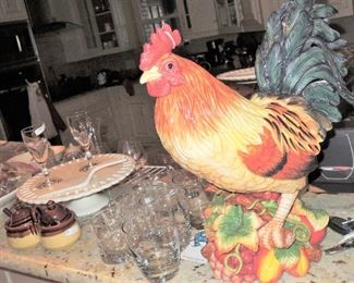 Ceramic Rooster, bar glasses, wine stems and stemless crystal.  Cake platters and condiment servers