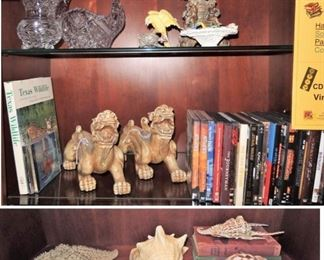 Large sea shells, Foo dogs, movie DVDs, American Brilliant Crystal