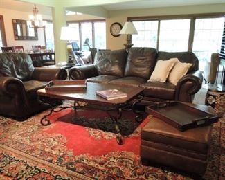 Extra-large rug - Leather oversize ottoman, club chair and sofa.  Large wood and iron coffee table