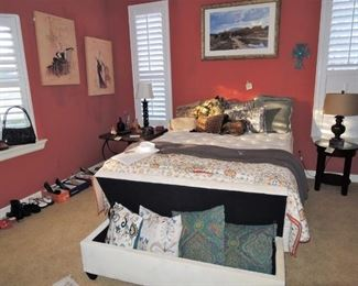 Queen size bed. Feminine art, side tables.  Storage Bench, selection of lamps. Museum Prints.  Woman's shoes, decorator throw pillows