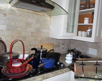 Kitchen basics.  Stainless toaster, pots and and pans including LeCruiset