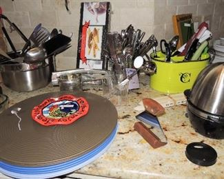 Chargers, place mats and linens.  Quality flatware set, utensils, small appliances
