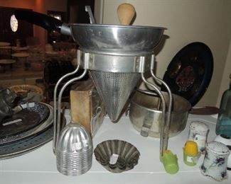 Vintage kitchen: ricer, molds, salt and peppers, mason jars, tin plates and pie plates, sifters, cookie press