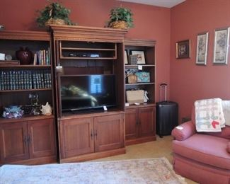 Media  cabinet and shelves.  Luggage. Floral.  Leather bound books