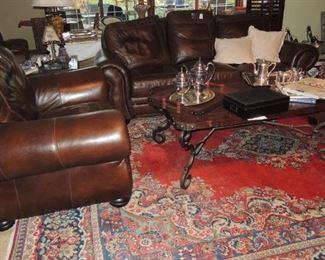 Leather sofa, large chair, Turkish rug, wood and iron coffee table