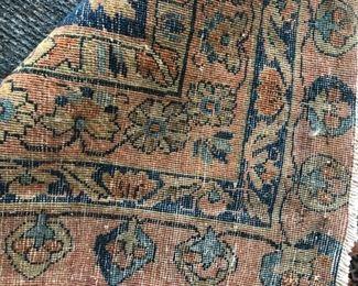 back of the antique rug