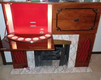 KORONETTE STEREO / PS - STEREO - BAR - RADIO - RECORD PLAYER - AM / FM  AND FIREPLACE WITH BUILT IN SPEAKERS . TOP PANELS DROP DOWN.