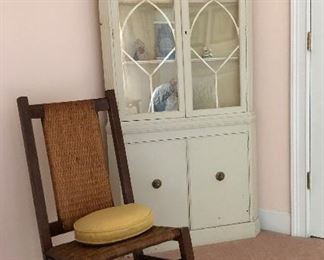 Cane back and seat oak rocker, white corner cabinet