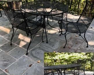 Round wrought iron table with four chairs
