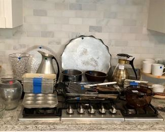 Assortment: Aluminum, baking pans, cookware, pots, vases, mugs, carafe's, knives...