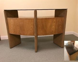 Mid century bar made of wood with suede accents and glass top