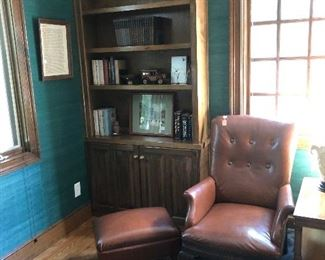 Brown leather straight back chair with matching ottoman
