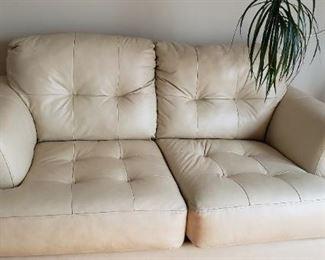 Leather cream colored Love Seat