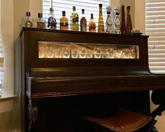 19th century piano converted into backlit  Liquor display piece