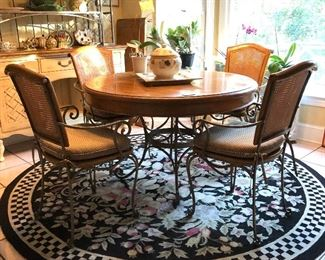 Round Kitchen table with 4 chairs. Plants and Wicker stand not for sale.