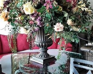 Floral arrangements and large glass octagon table on a beautiful metal base from the 60's.
