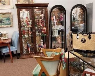 Lots of collectibles including signed Kachinas, milk glass, lighthouses. Purses and jewelry too.