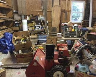 The garage: lumber, RotoTiller, Supplies