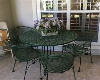 green iron  patio table with 4 chairs