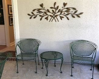 green iron patio chairs and table