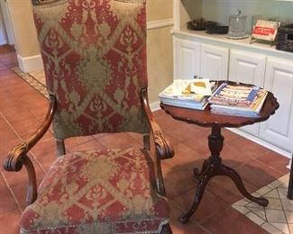 Regal looking chair with a nice mahogany pie crust side table.