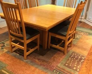 . . . a beautiful mid-century/Danish-modern looking table with area rug