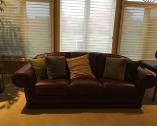 This is a beautiful leather couch in a maroon shade -- owner is not 100 percent sure on its availability.