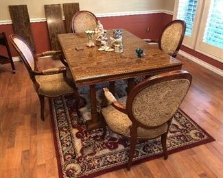 Table with 3 leaves and 4 arm chairs, *Will sell separately