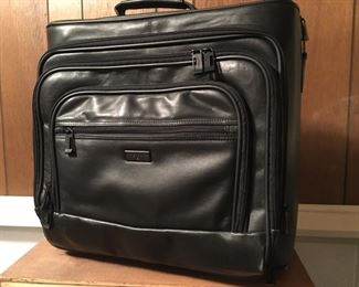 Handsdome/Beautiful Leather Compact Travel Bag w/Handle and Wheels--you'll save $ every time you use it!