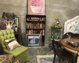 Chairs and books and art. Plus a huge brass lantern.