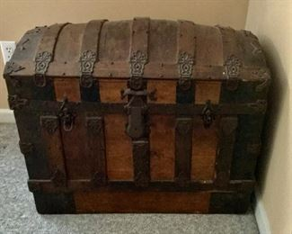 Vintage camelback trunk complete with interior organizers. We found vintage treasures in this trunk!