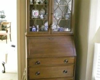 Lovely antique secretary/desk with three drawers and glass doors