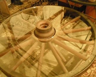 AMAZING coffee table made from an authentic 1800's wagon wheel with glass top. Truly exceptional!! You must see this!